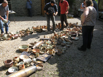 Course participants inspecting pots