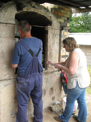 Tim and Tina packing the soda kiln